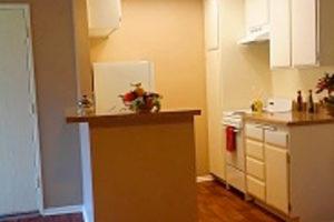 Kitchen with tan countertops, Island countertop